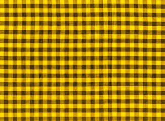 The texture of the bright yellow of binding gingham fabric. Yellow textile background. Fabric plaid. Close-up