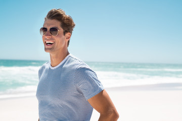 Happy man smiling at beach