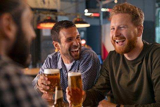 Friends enjoying draft beer at pub