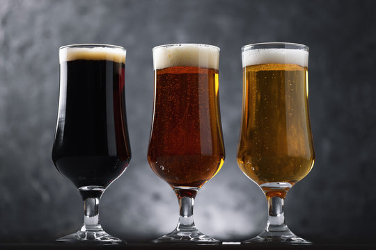 Choose from three different types of craft beer in glasses on a dark background
