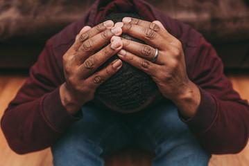 black african american man depicting a sad depressive state, depression concept Fotomurales