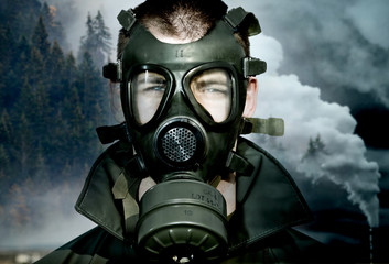 environmental disaster and pollution wearing gas mask