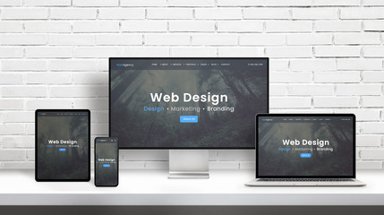 Web design agency concept presentation on displays of different dimensions. Modern flat web design template, theme concept. White brick wall in background