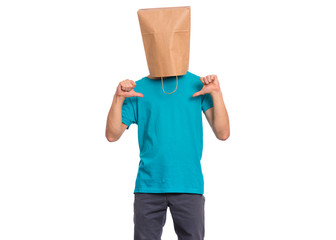 Fototapete - Portrait of teen boy with paper bag over head making thumbs up gesture. Teenager cover head with bag pointing thumbs on himself. Child pulling paper bag over head isolated on white background.