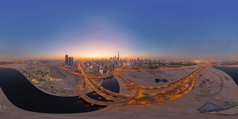 Garden Poster Deep brown 360 panorama by 180 degrees angle seamless panorama of aerial view of Dubai Downtown skyline and highway, United Arab Emirates or UAE. Financial district in urban city. Skyscraper buildings at sunset.