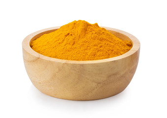 turmeric powder in wood bowl on white background
