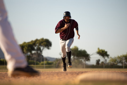 Baseball player running to a base during a match