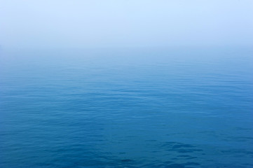 Vast blue sea with the mist background Fotobehang
