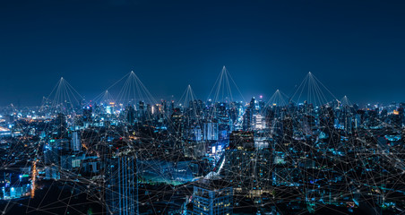 Modern city with wireless network connection and city scape concept.Wireless network and Connection technology concept with city background at night. Fototapete