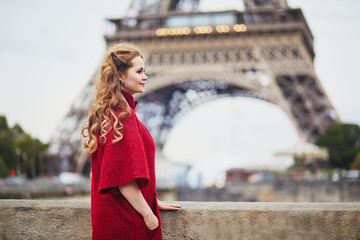 Young woman with long blond curly hair in Paris, France Wall mural
