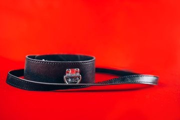 sex toys collar with leash isolated on red background Fotobehang