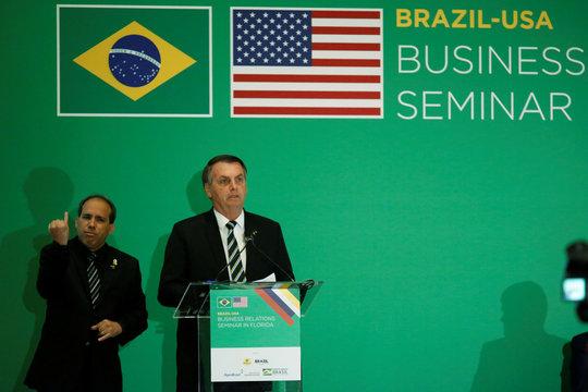 Brazilian President Jair Bolsonaro speaks during the Brazil-USA Business Relations Seminar, in Miami