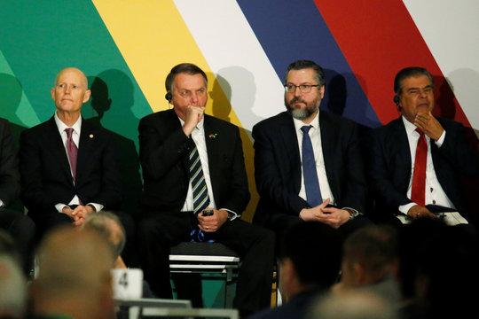 Brazilian President Jair Bolsonaro yawns during the Brazil-USA Business Relations Seminar, in Miami