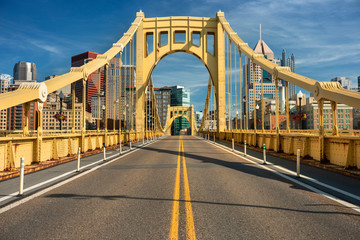 Traffic and people cross the Allegheny River on the Roberto Clemente Bridge in downtown Pittsburgh...