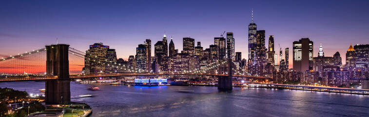 Poster New York Brooklyn Bridge over the East River and the Manhattan downtown city panoramic skyline at night in New York USA