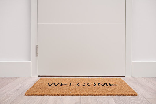 White door with a welcome mat