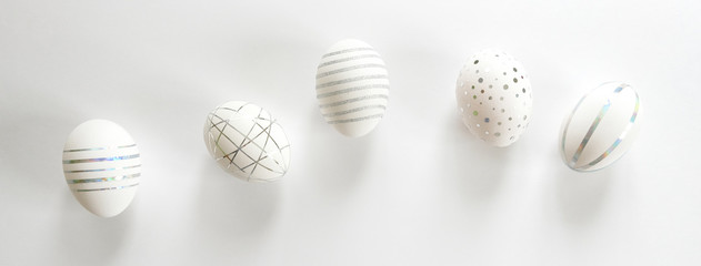White easter eggs with silver pattern on white