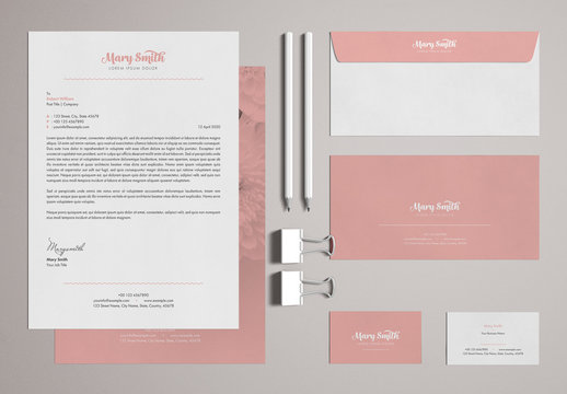 Stationery Set Layout with Pink Accents