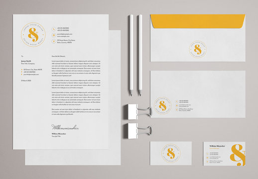 Stationery Set Layout with Yellow Accents