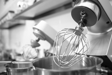 Professional steel electric mixer for kneading dough, cream in restaurant kitchen
