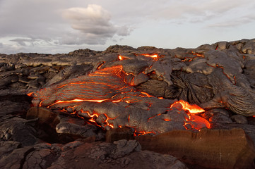 Hawaii - lava emerges from a column of the earth