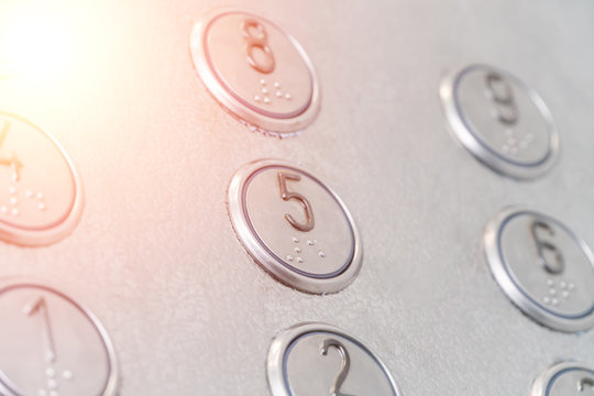 Elevator buttons with Braille close-up, Photo with illumination