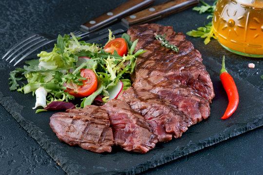 skirt steak with vegetable salad