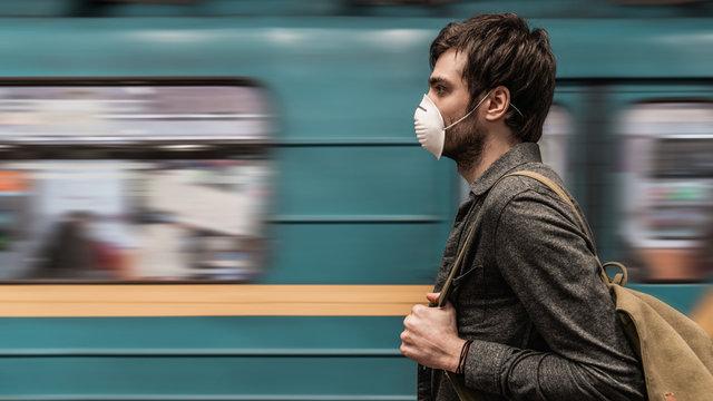 Man wearing face mask for protect at subway station platform
