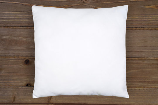 White Throw Pillow Mockup on Rustic Brown Wood