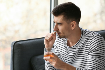 Canvas Prints Bar Depressed young man drinking alcohol at home