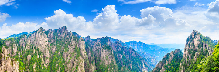 Photo on textile frame Blue sky Beautiful Huangshan mountains landscape on a sunny day in China.