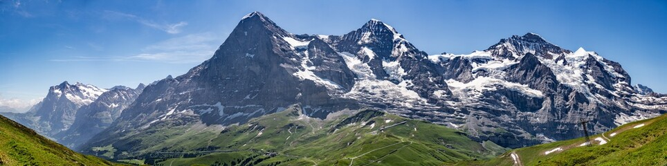 Switzerland, Panoramic view on Eiger, Monch and Jungfraujoch and green Alps around Mannlichen