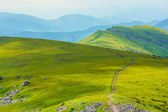 path through mountain range. beautiful alpine meadows of carpathian landscape on a cloudy day in summer. dividing watershed ridge