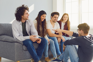 A group of friends talking in a room.