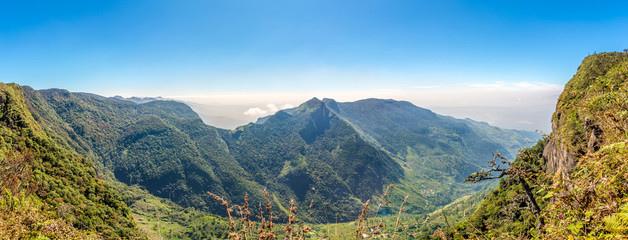 Wall Mural - Panoramic view of the valley from mountain saddle Worlds End in Horton Plains National Park - Sri Lanka