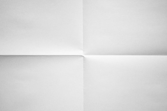 White paper folded in four fraction background