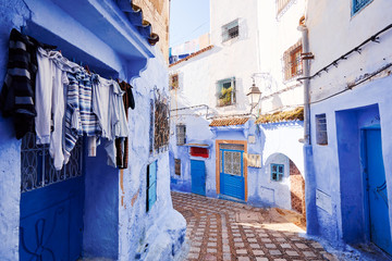 Poster Maroc Public pedestrian street in old town Medina of Chefchaouen, Morocco. Chefchaouen or Chaouen is known that the houses in this city are painted in blue.