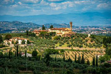 Aluminium Prints Blue Wide angle view of typical Italian landscape with olive trees, old houses and blue sky. Travel destination Tuscany, Italy