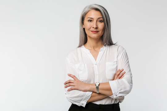 Image of adult mature woman with long gray hair wearing office clothes