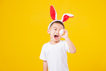 little children boy smile standing so happy bunny ears in Easter festival day holding easter eggs
