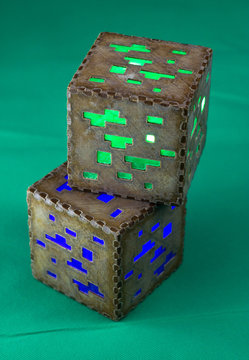 Minecraft cubes made of plastic. Two brown minecraft cubes with glowing Windows