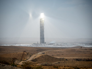 solar thermal power plant in the middle in of the desert