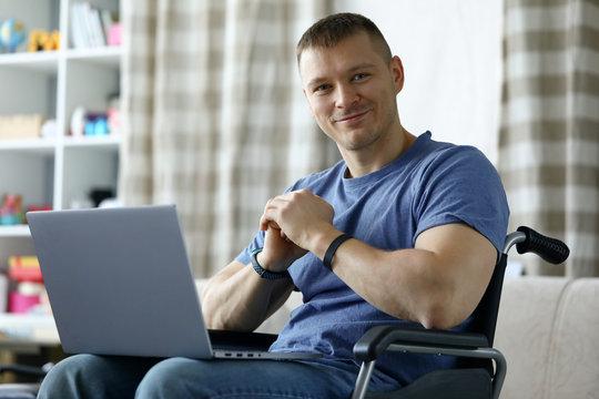 Cheerful man using computer