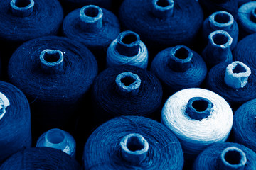 skeins of thread colored in trendy classic blue color