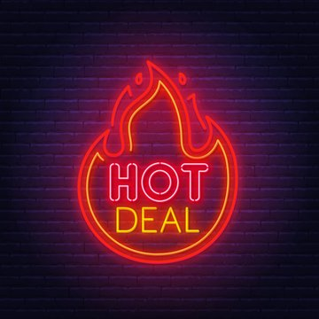 Hot deal neon sign on brick wall background .