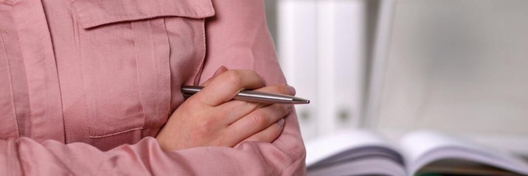 Businesslady holding pen