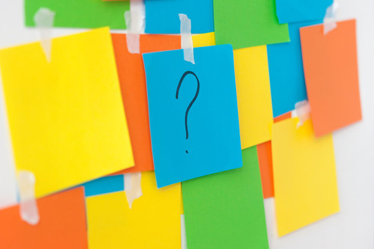 memo sheets on the wall with question mark
