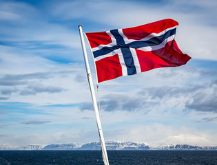 Norwegian Flag on the stern of a ship in the Artic circle