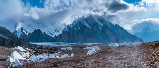 Panoramic view of Baltoro (front), Yermamendu Glacier (foothill) and ice pinnacles from Goro II with Urdukas Peak and Masherbrum behind the cloud in background, Pakistan