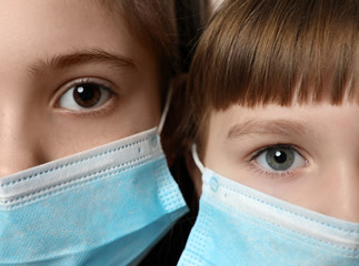 Close up of little girls wearing protective face masks